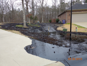 Tar sands oil flows onto a residential street in Mayflower, Arkansas. Source: EPA